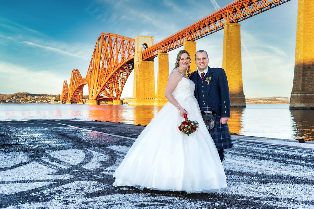 Bride & Groom Pose in front of Forth Rail Bridge, South Queensfery