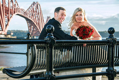 Bride & Groom Pose on Bench at Forth Rail Bridge