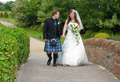 Bride & Groom Stroll on Bridge, Lochside House Hotel, New Cumnock