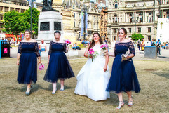 The Bride & Her Bridesmaids stroll Across George Square, Glasgow.