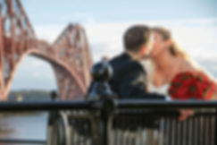 Bride & Groom Kiss in Front of Forth Railway Bridge, North Queensferry