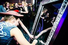 Photo of Woman Using Magic Mirror