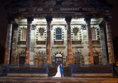 Bride & Groom Pose at night outside St Andrews in the Square, Glasgow