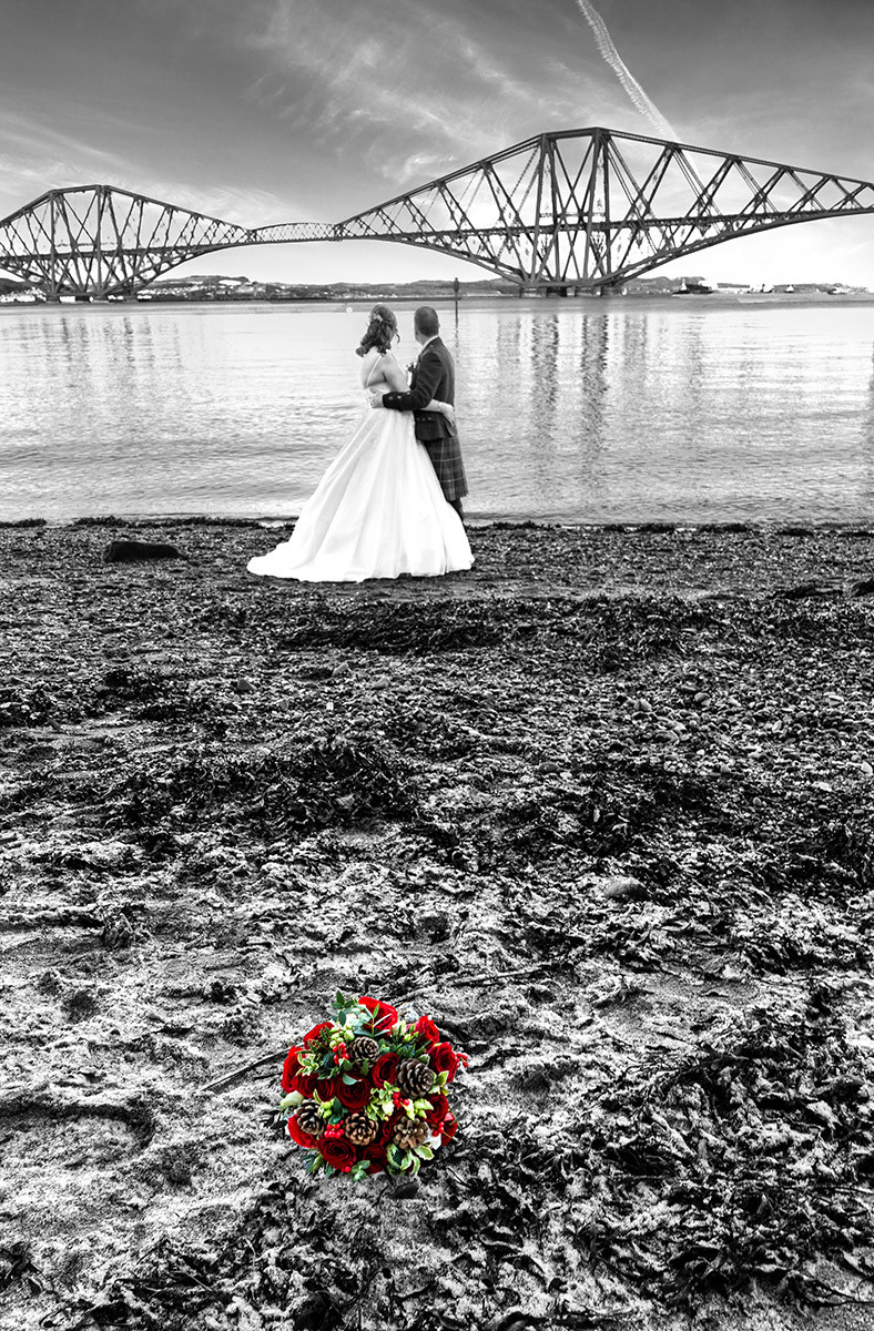 Bride & Groom Gaze Out Across River Forth at the Rail Bridge