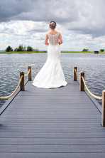 Bride stares out from the jetty. The Vu Bathgate.