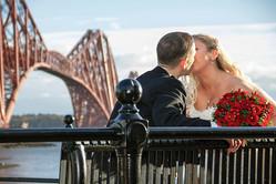 Bride & Groom Kiss Next to the Forth Rail Bridge.