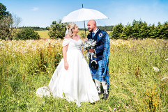 Bride & Groom Pose in the Long Grass