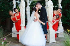 Bride & Groom Kiss Whilst Bridesmaids take a peek. Busby Hotel, Clarkston