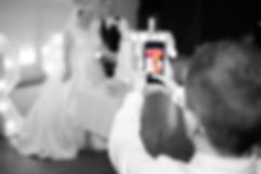Little Boy Taking a Picture of the Bride & Groom on His Phone