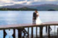 Bride & Groom Kiss on the Jetty, Duck Bay Hotel, Loch Lomomd
