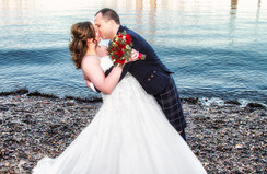 Bride & Groom Kiss on the beach, South Queensferry.