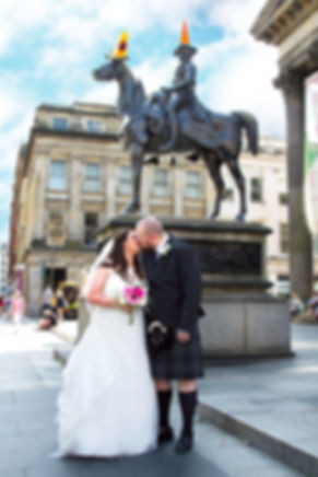 Bride & Groom Kiss at the Wellington Statue, Glasgow