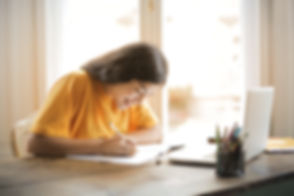 Canva - Woman in Yellow Shirt Writing on