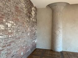 Faux aged brick wall finish