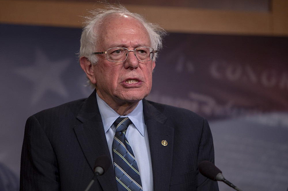 Bernie Sanders giving a speech, looking angry, annoyed