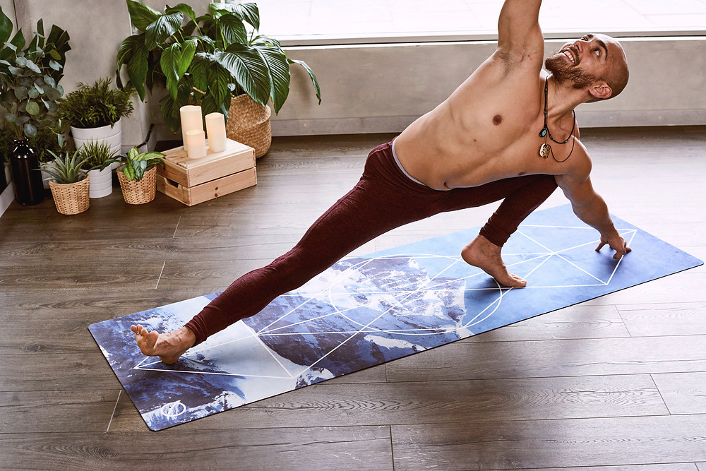Man doing yoga on yoga mat indoors