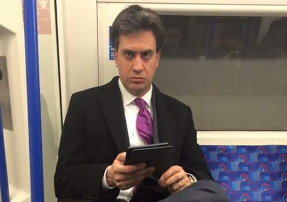 Ed Milliband with ipad on tube staring