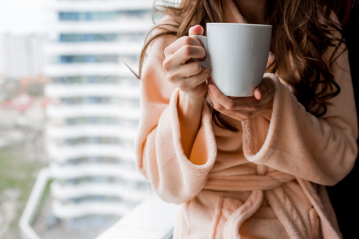 woman-bathrobe-holding-cup-hot-tea-outum