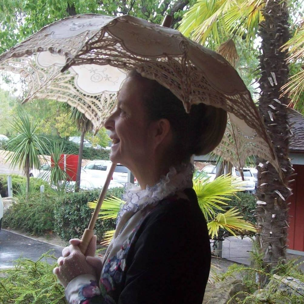 Phoebe smiling with umbrella