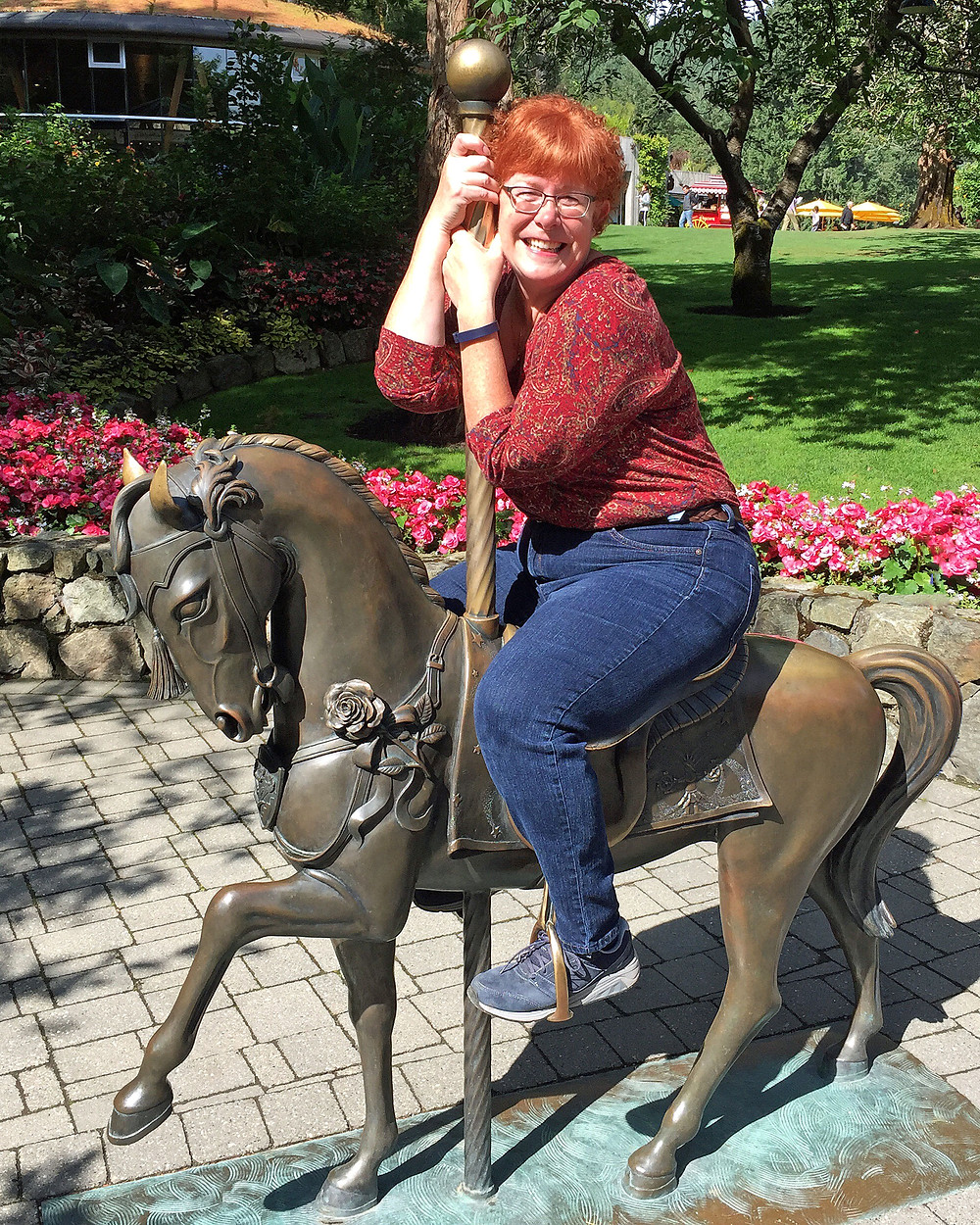 Suzy 2.0 on a merry go round horse sculpture