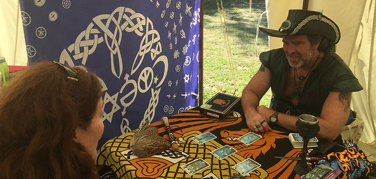 Psychic Bruce Hoskins (Lord Fafnir) performing a tarot card reading