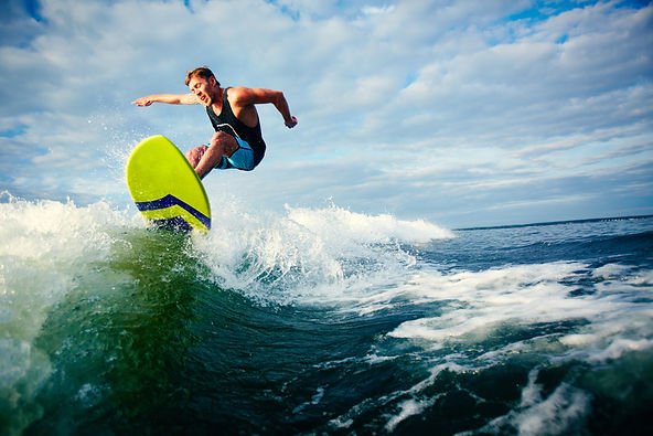 courageous-surfer-riding-wave.jpg