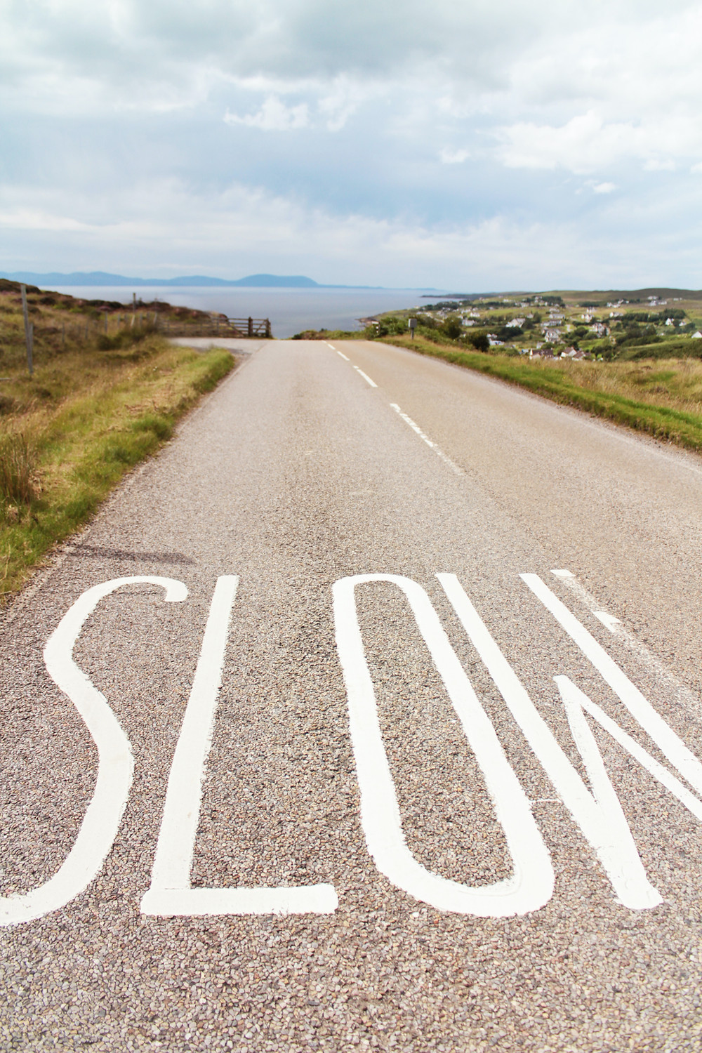 the word slow spelled out on a road