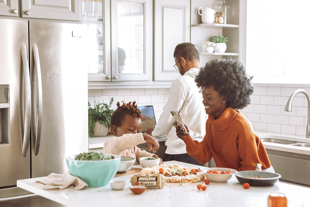Family finds new things to do, like cooking together, during COVID in the winter.Catalyss Counseling provides treatment for postpartum depression in Colorado through online therapy and in person counseling in the Denver area 80209 and 80210