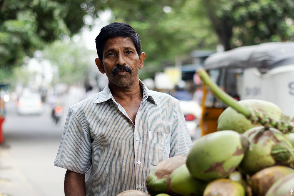 Coconuts are street food that help you save money while traveling