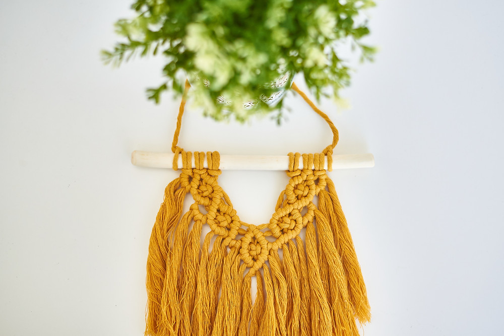 Mustard coloured hand woven macrame wedding arch