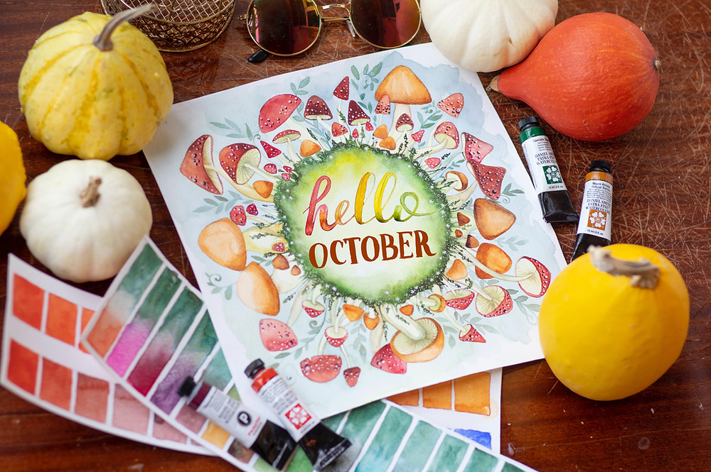 hello October watercolor art on table with pumpkins and watercolors