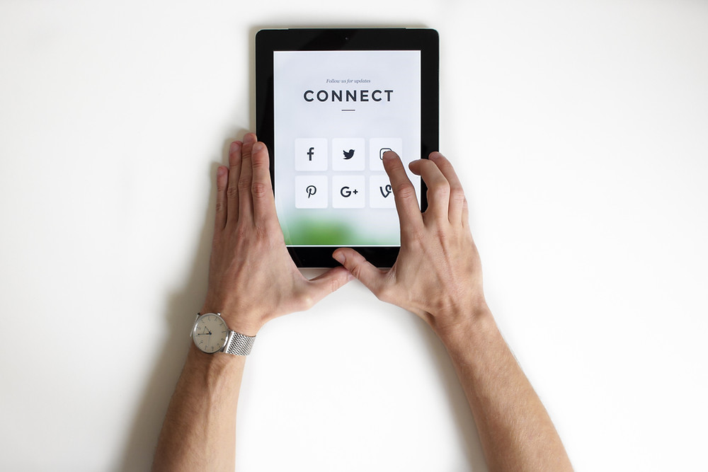 A ipad displaying social media icons and the heading Connect