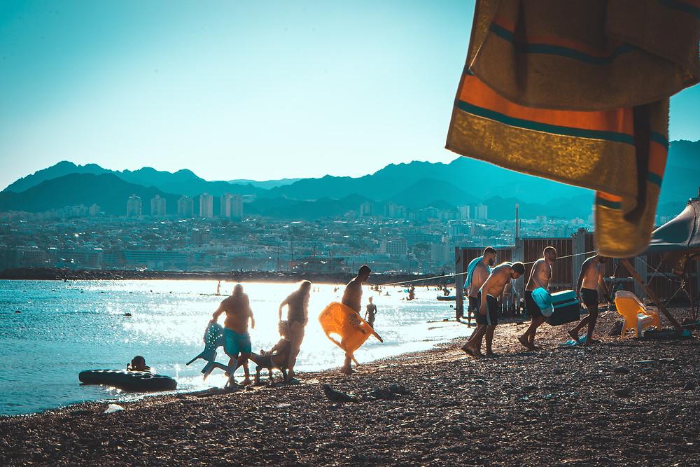 People enjoying the sun and beach in Eilat