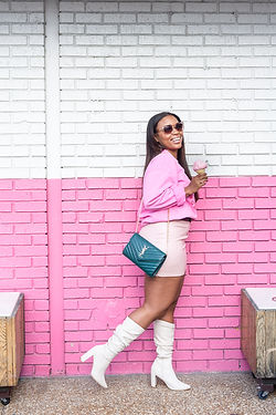 stylish woman wearing white boots holding an ice cream with great accessories