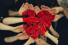 Red heart painted on hands