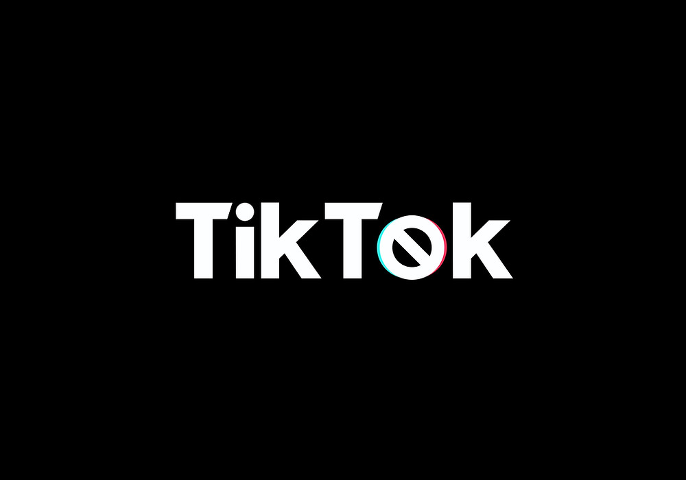 Black photo with text 'tik tok' and with a 'banned' symbol as the 'o'