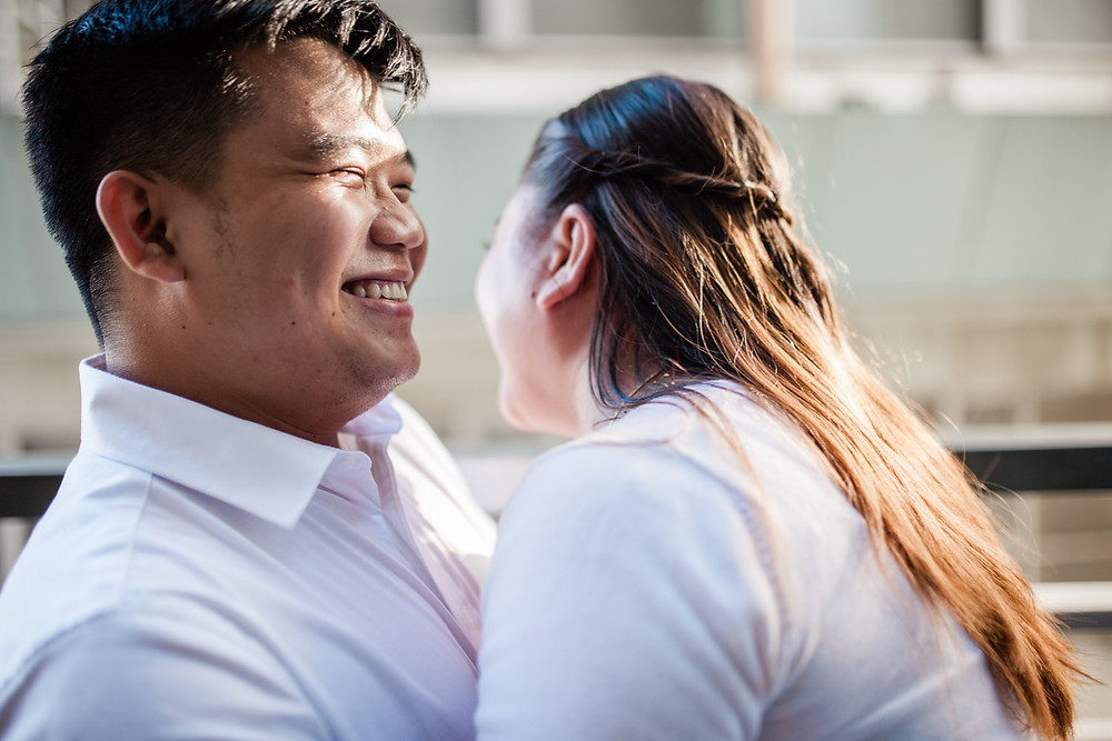 Happy couple laughing with each other. Couples counseling at Marble Wellness can help you with communication tips to boost your relationship, and other strategies to have a positive partnership.