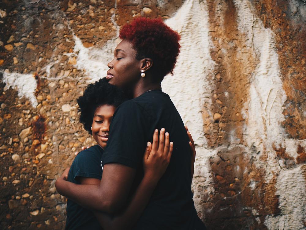 African American parent hugging child
