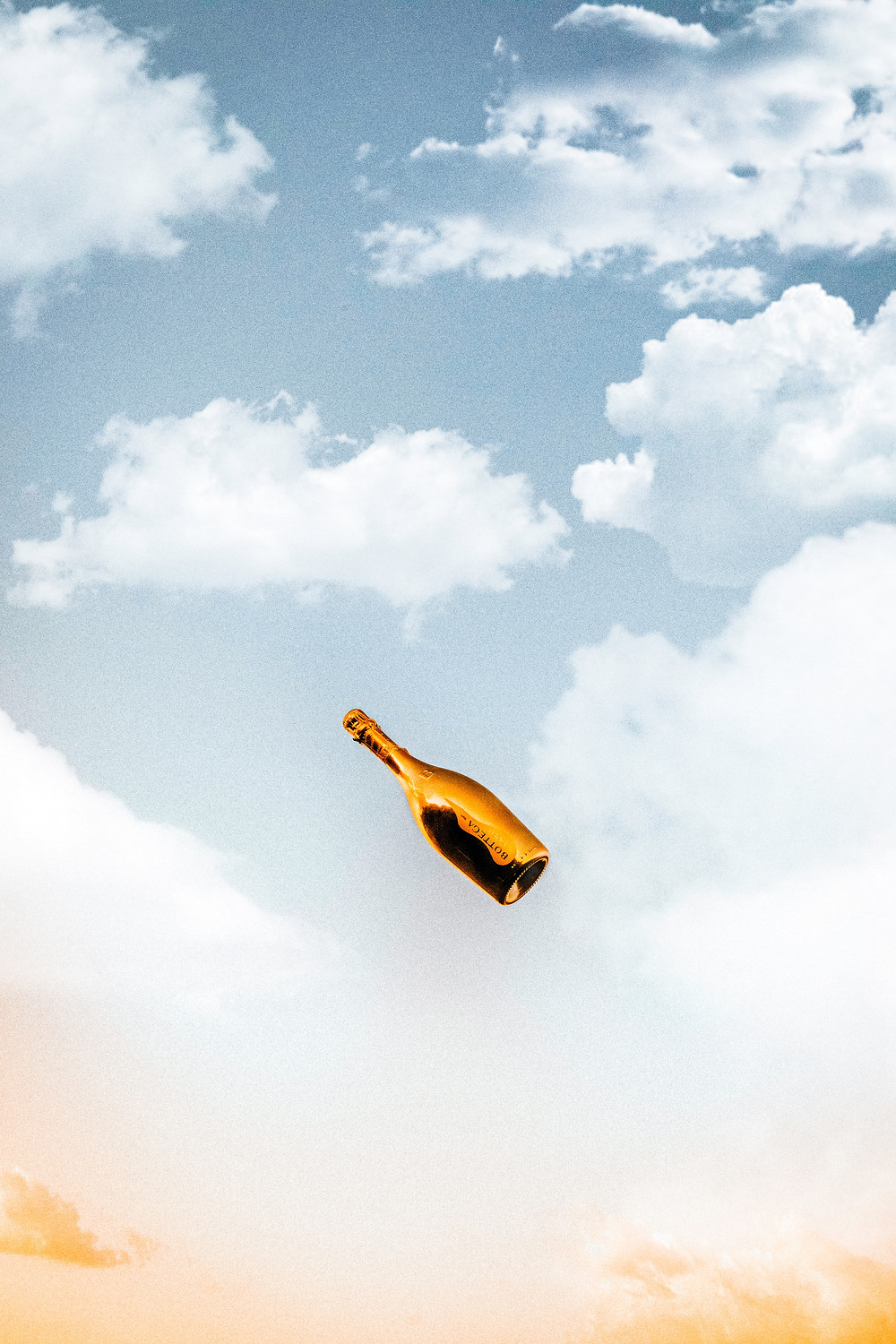 Champagne bottle in the sky