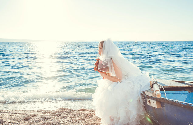 bride stairing out into ocean