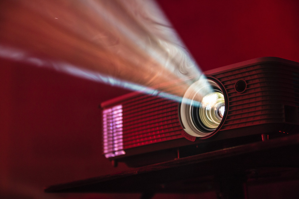 Photo of lit projector by Alan Litvin