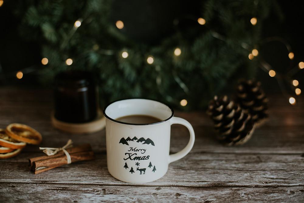 """Mug with coffee saying """"Merry Xmas"""""""