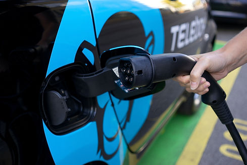 feemales is charging electric vehicle