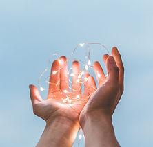 Hands holding fairylights