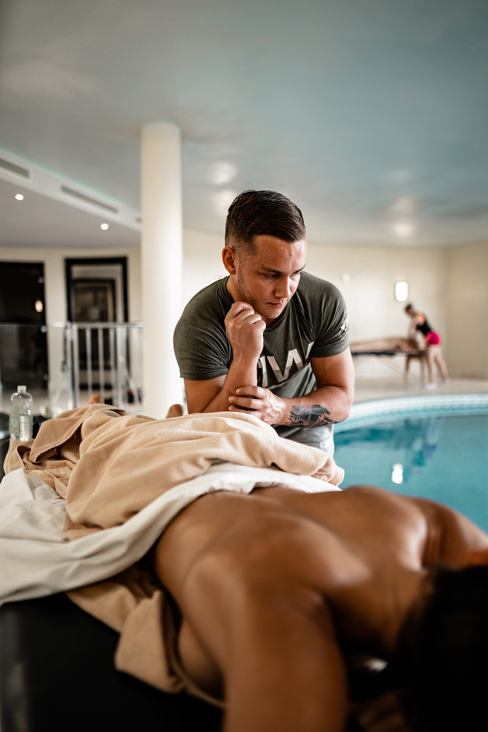 Man giving a massage in a spa