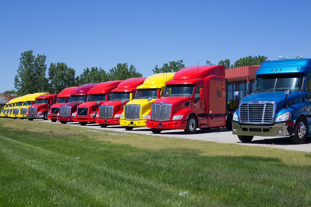 Trucks parked outside a trucking company