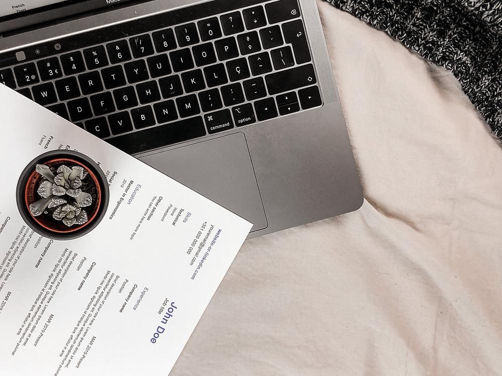 FAC3 customer using laptop and reading cv