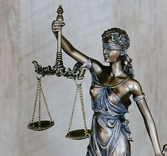 Tingey Injury Law Firm lady justice holding scales