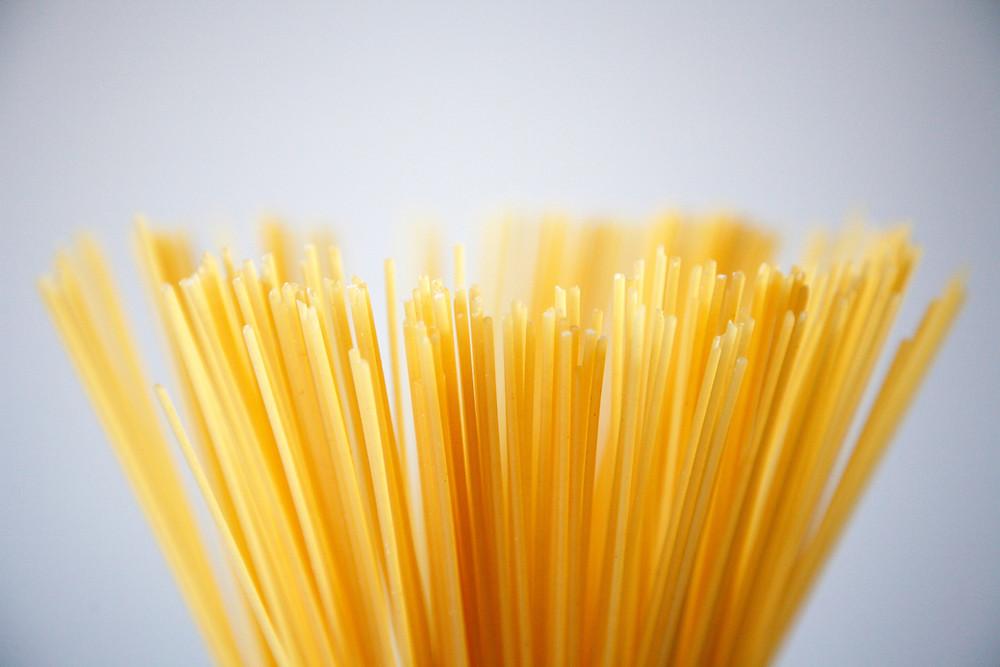 Sticks of uncooked pasta