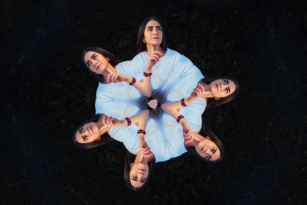 Kaleidoscope Image of Woman in Blue Thinking